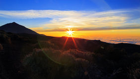 Sunset above the clouds silhouetting Teide Volcano Stock Images
