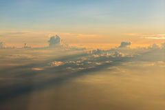 Sunset above the clouds Stock Photography
