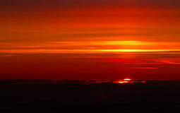 Sunset above the clouds, warm red colours. Stock Photos