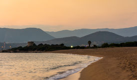 Sunset above Corsica. Mountains and beach royalty free stock image