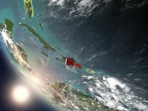 Sunset above Dominican Republic from space. Illustration of Dominican Republic as seen from Earth's orbit during sunset with visible country borders. 3D Stock Photo