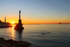 Sunset above embankment of Sevastopol stock photo