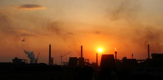 Sunset above factory Stock Photo