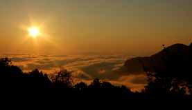 Sunset. Above fog sea on high mountain Stock Images