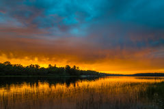 Sunset above forest lake Royalty Free Stock Image