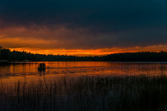 Sunset above forest lake Royalty Free Stock Photography