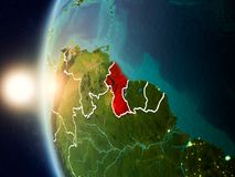 Sunset above Guyana from space. Illustration of Guyana as seen from Earth's orbit during sunset with visible country borders. 3D illustration. Elements of this Royalty Free Stock Image