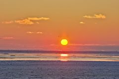 Sunset above ice sea Royalty Free Stock Image