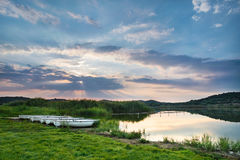 Sunset above the lake with boats Royalty Free Stock Photography