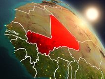 Mali from space during sunrise. Sunset above Mali from space on planet Earth with visible country borders. 3D illustration. Elements of this image furnished by Stock Photography