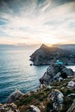 Sunset above mountain cliff in sea, view from Balaklava hill, beautiful nature landscape, travel destinations. Concept royalty free stock photos