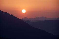 Sunset above mountain Stock Photography