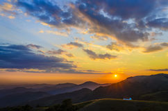 Sunset above mountain peak Royalty Free Stock Photos