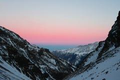 Sunset above the mountains ridge. Caucasian Mountains. Russia stock photo