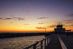 Melbourne City, St. Kilda Pier. Sunset above the ocean, Melbourne City, St. Kilda Pier, Australia Stock Photography
