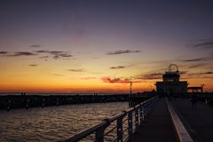 Melbourne City, St. Kilda Pier. Sunset above the ocean, Melbourne City, St. Kilda Pier, Australia Royalty Free Stock Images