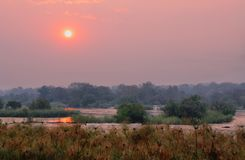 Sunset above Okavango river Stock Images