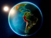 Peru with sunset from space. Sunset above Peru highlighted in red on planet Earth with visible country borders. 3D illustration. Elements of this image furnished stock images