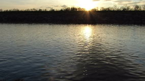 Sunset above the river. Beautiful sunset above the river stock footage