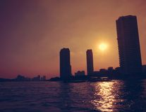 Sunset above the river. Beautiful sunset above the river and three building at bangkok Stock Photo