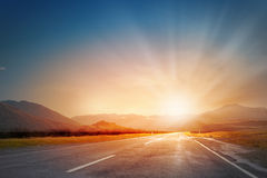 Sunset above road Stock Image