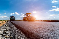 Free Sunset Above Road Roller Working On The Construction Site Royalty Free Stock Image - 79652896