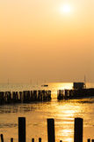 Sunset above the sea, and electronic poles are drownig. Stock Photography