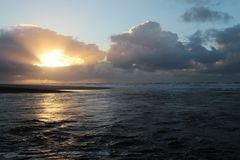 Sunset above sea seen on the beach of Katwijk, Netherlands.  royalty free stock photo