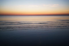Sunset above sea shot from beach Stock Images
