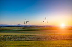 Sunset above the windmills Royalty Free Stock Photo