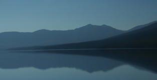 Sunset abstract,mountain reflections. On McDonald Lake,Glacier National Park, Montana stock image