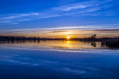 Sunset at the Achterwasser Lagoon near Zinnowitz Stock Image