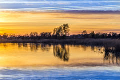 Sunset at the Achterwasser Lagoon near Zinnowitz Royalty Free Stock Photos