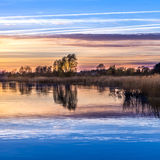 Sunset at the Achterwasser Lagoon near Zinnowitz Royalty Free Stock Images