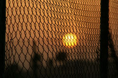 Sunset across the border. Sunset in the other side of desert border fencing stock photo