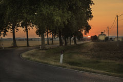 Sunset across the road - Tuscany Stock Image