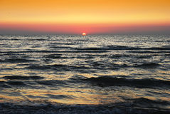 Sunset on Adreatic sea. Adreatic sea wih sun and skies on horizon Stock Images