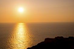 Sunset in the Aegean Sea. Bright orange sunset over the Aegean sea near the island of Santorini, Greece stock photography