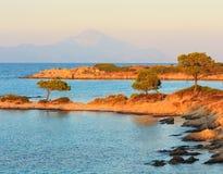 Sunset Aegean sea coast Chalkidiki, Greece. Aegean sea coast landscape, sunset view from Karidi beach Chalkidiki, Greece Stock Photo