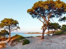 Sunset Aegean sea coast Chalkidiki, Greece. Aegean sea coast landscape in sunset sun rays. View from Karidi beach Chalkidiki, Greece Royalty Free Stock Photography
