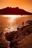 Sunset on Aegina Island. Sunset Aegina Island, Greece with silhouette of a young boy stock image