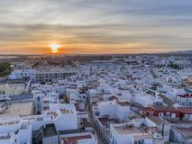 Sunset aerial cityscape in Olhao, Algarve fishing village view of ancient neighbourhood of Barreta. And its traditional cubist architecture. Portugal Stock Images