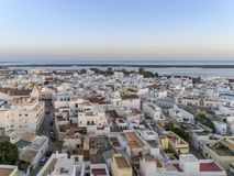 Sunset aerial cityscape in Olhao, Algarve fishing village view of ancient neighbourhood of Barreta. And its traditional cubist architecture. Portugal Stock Photos
