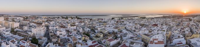 Sunset aerial cityscape in Olhao, Algarve fishing village view of ancient neighbourhood of Barreta. And its traditional cubist architecture. Portugal Royalty Free Stock Image