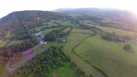 Sunset aerial farm flyover with lens flare. Video of sunset aerial farm flyover with lens flare stock video footage