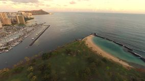 Sunset aerial overlooking Honolulu's Ala Moana Beach stock video