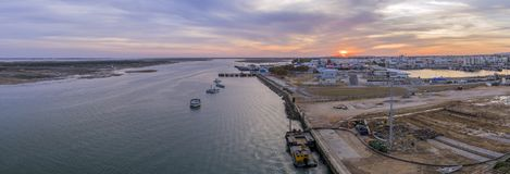 Sunset aerial panoramic seascape view of Olhao dockyard, waterfront to Ria Formosa natural park Stock Photos