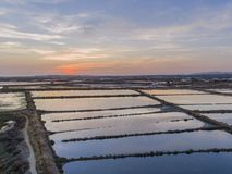 Sunset aerial seascape view of Olhao salt marsh Inlet. Waterfront to Ria Formosa natural park. Algarve. Portugal Stock Image