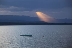 Sunset in Africa. Sunset through the clouds over a lake Stock Photos