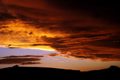 Sunset in Africa. Sunset over silhouetted cloudy sky Stock Photos